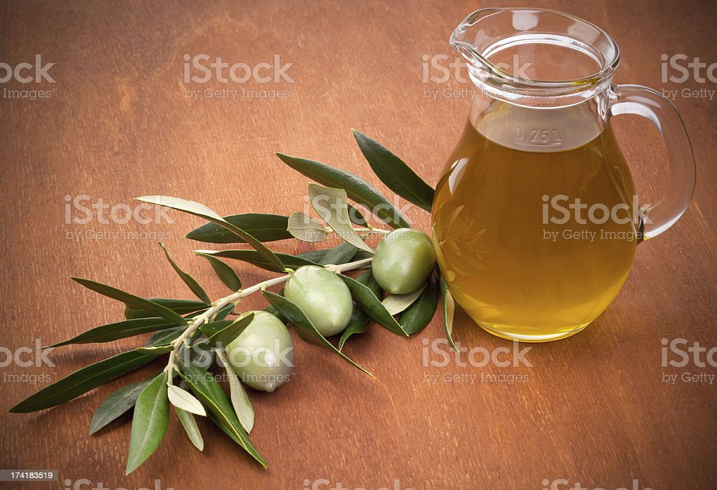 Olives and a bottle of olive oil royalty-free stock photo