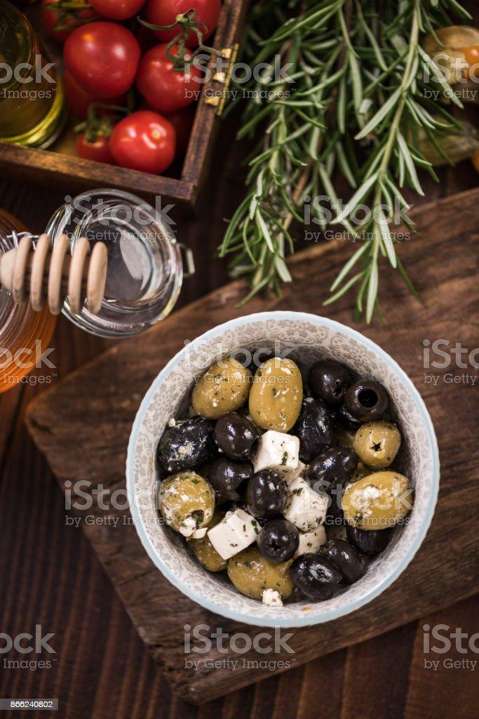 Olives and feta salad in bowl,spanish tapa bar food stock photo