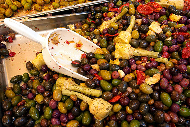 Olives, artichokes and spices. - foto stock