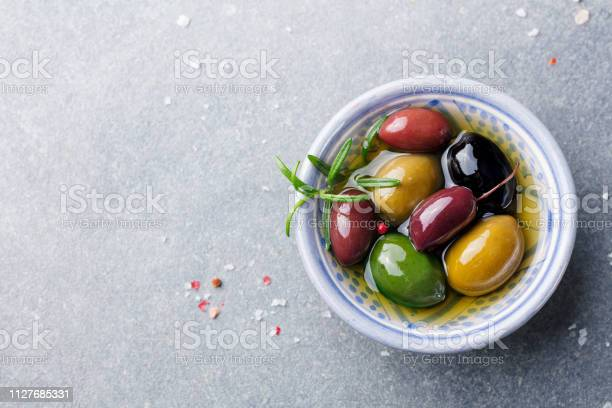 Olives assortment in bowl with oil top view copy space picture id1127685331?b=1&k=6&m=1127685331&s=612x612&h=3 ebjhu 0zqzz qhmqwzfdg8dxpfdsb8gaoj7s9yuri=