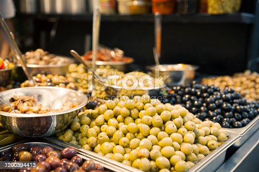 Close up view at a variety of olives for sales in the market.