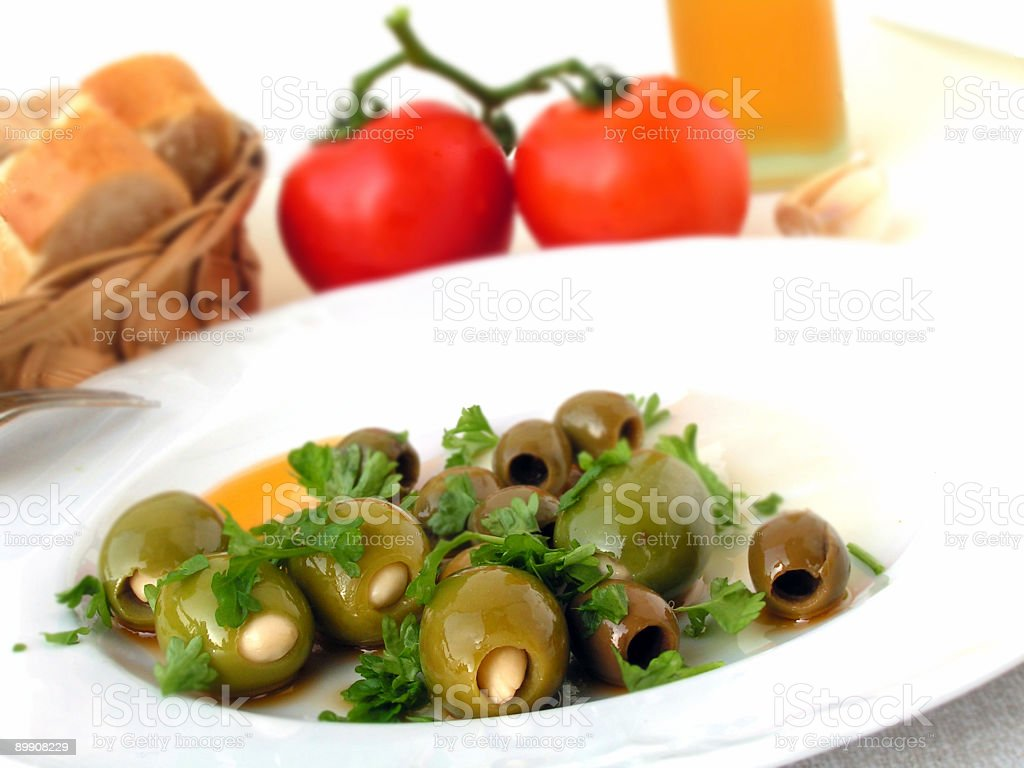 olives cocktail with slices of baguette royalty-free stock photo