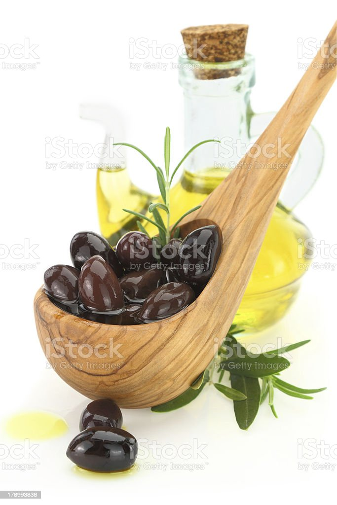 Olives in a wooden spoon royalty-free stock photo