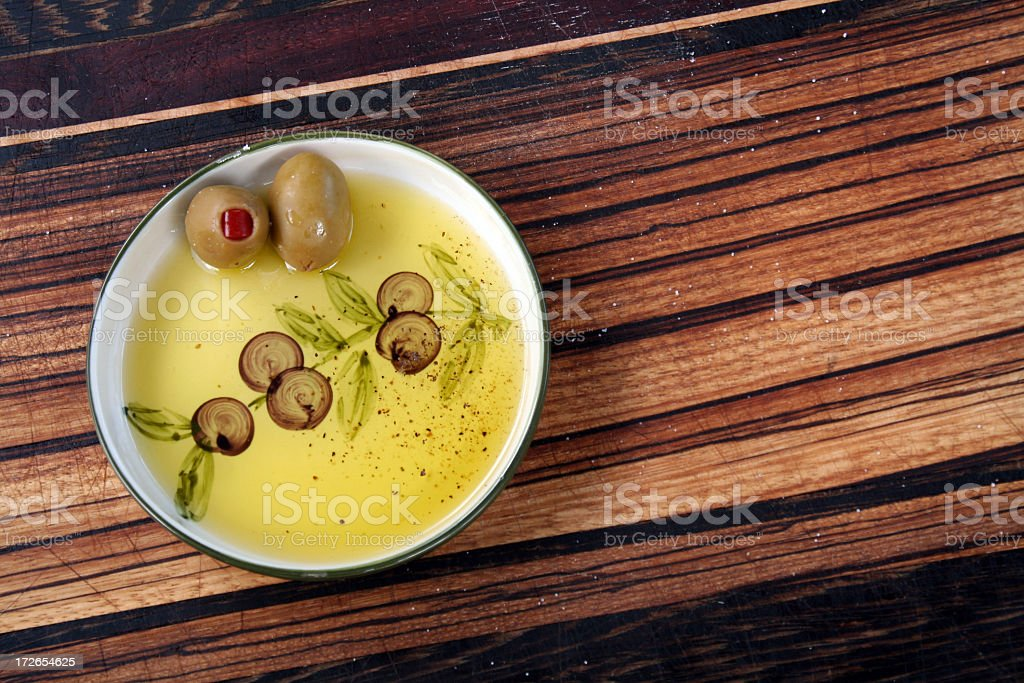 Olives in oil on wood royalty-free stock photo