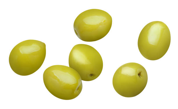 Olives on white Flying green olives, isolated on white background olives stock pictures, royalty-free photos & images