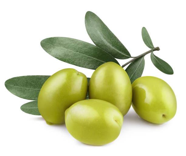 Olives on white Delicious green olives with leaves, isolated on white background olives stock pictures, royalty-free photos & images