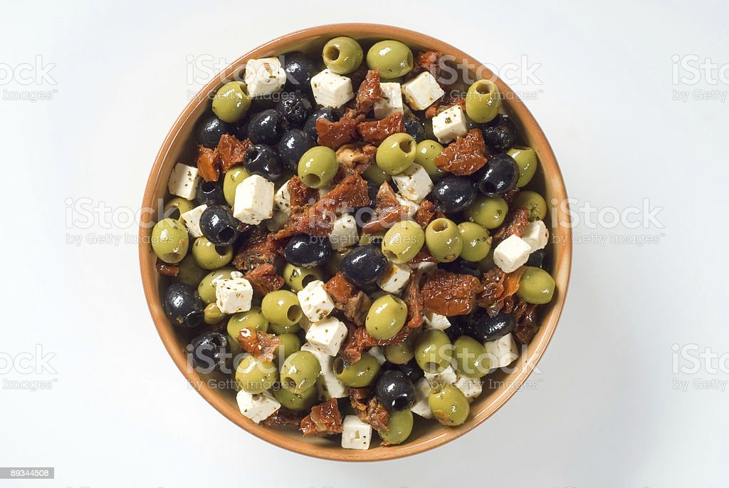 Olives with feta and dried tomatoes royalty-free stock photo