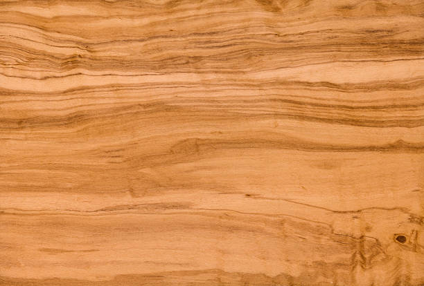 Olivewood Wood Grain Background Polished Olivewood wood grain texture. Natural finish, with great care taken with white balance to preserve the original colors. exoticism stock pictures, royalty-free photos & images