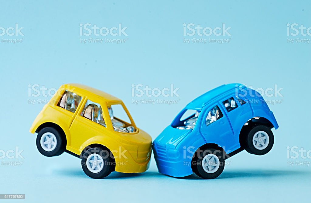 Ð¡ollision of two toy cars on a blue background - Photo