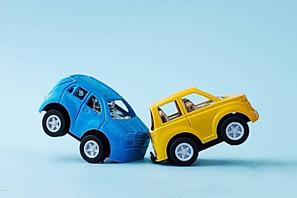 Ð¡ollision of two toy cars on a blue background stock photo