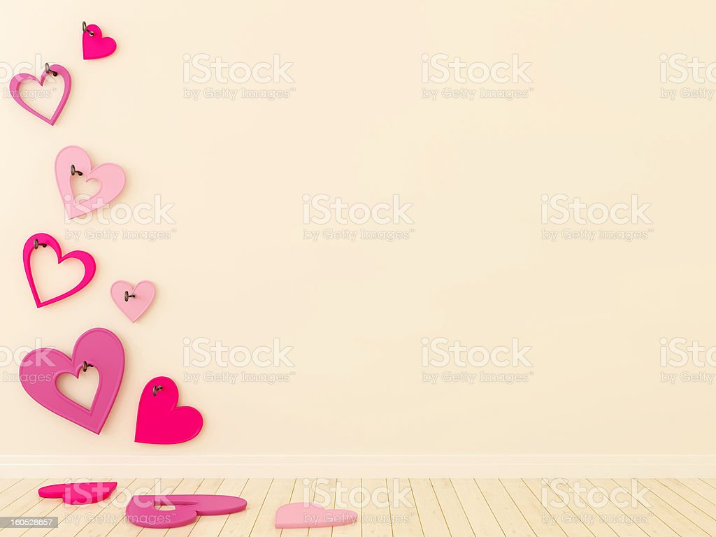 Сolored hearts on the wall royalty-free stock photo