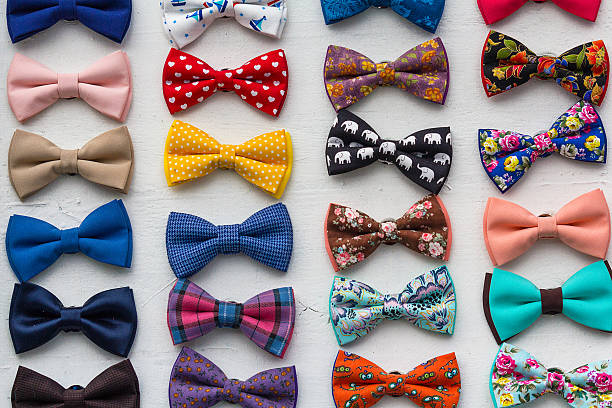 Сolorful bow ties are located in the window. Styles stock photo