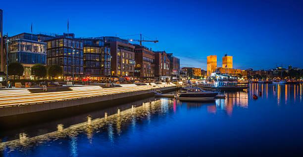 olso illuminated harbour waterfront aker brygge restaurants apartments panorama norway - oslo city hall stockfoto's en -beelden