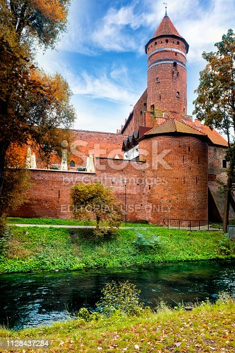 Olsztyn, Poland - August 31, 2018: Castle of Warmian Bishops in Olsztyn, Poland. The castle built in the fourteenth-century in the Gothic architectural style. The most well-known administrator was Nicolaus Copernicus between 1516 and 1521