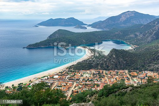 istock Oludeniz Bay view in Fethiye Town. Amazing landscape from Lycian way. Travel destination. Summer and holiday concept. Blue Lagoon. 1135398157