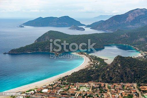 istock Oludeniz Beach and Blue Lagoon, Fethiye, Mugla, Turkey. Amazing Oludeniz beach landscape. Summer and holiday concept. Landscape from Lycian way 1135398129