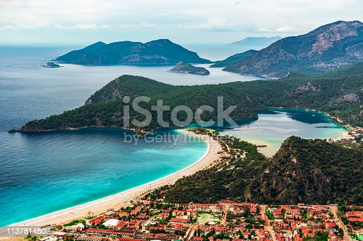 istock Oludeniz Beach and Blue Lagoon, Fethiye, Mugla, Turkey. Amazing Oludeniz beach landscape. Summer and holiday concept. Landscape from Lycian way. 1137814802