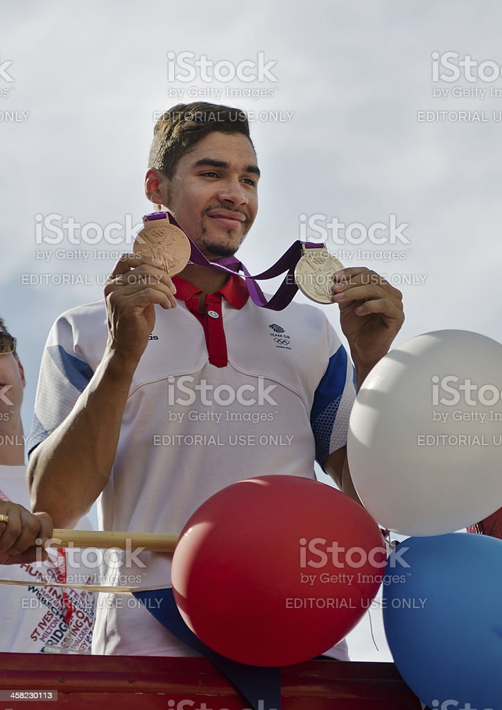 Olympic Gymnast Louis Smith with his bronze and silver medals. stock photo