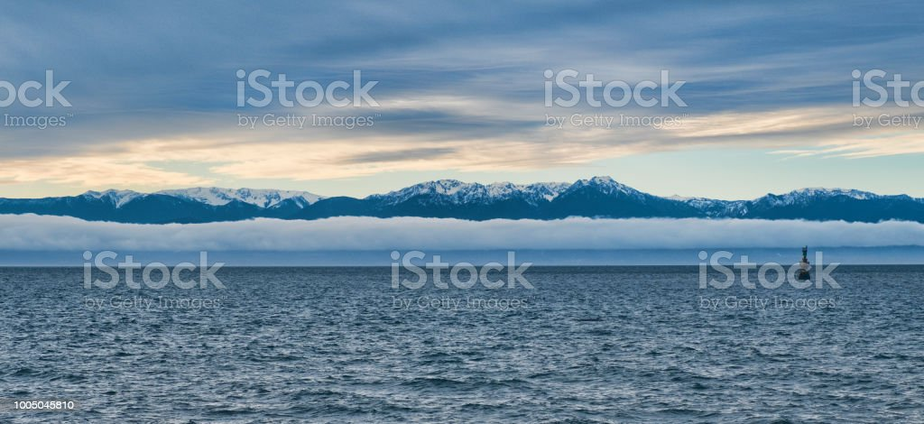 Olympic Mountains in Washington as seen from Victoria, Canada stock photo