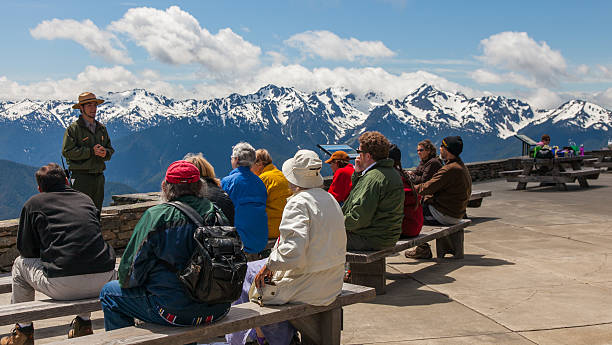 Olympic National Park - July 2011 Port Angeles, Washington, USA - July 22, 2011: Visitors enjoy a Ranger talk in the Visitor Center patio of the Hurricane Ridge Visitor Center in the Park in the summer of 2011 park ranger stock pictures, royalty-free photos & images