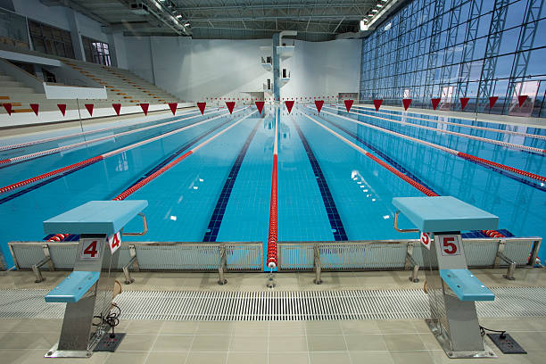 Royalty free olympic swimming pool pictures images and stock photos istock for Olympic swimming pool pictures