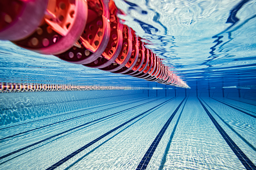 Olympic Swimming Pool Under Water Background - Fotografie stock e altre immagini di Acqua