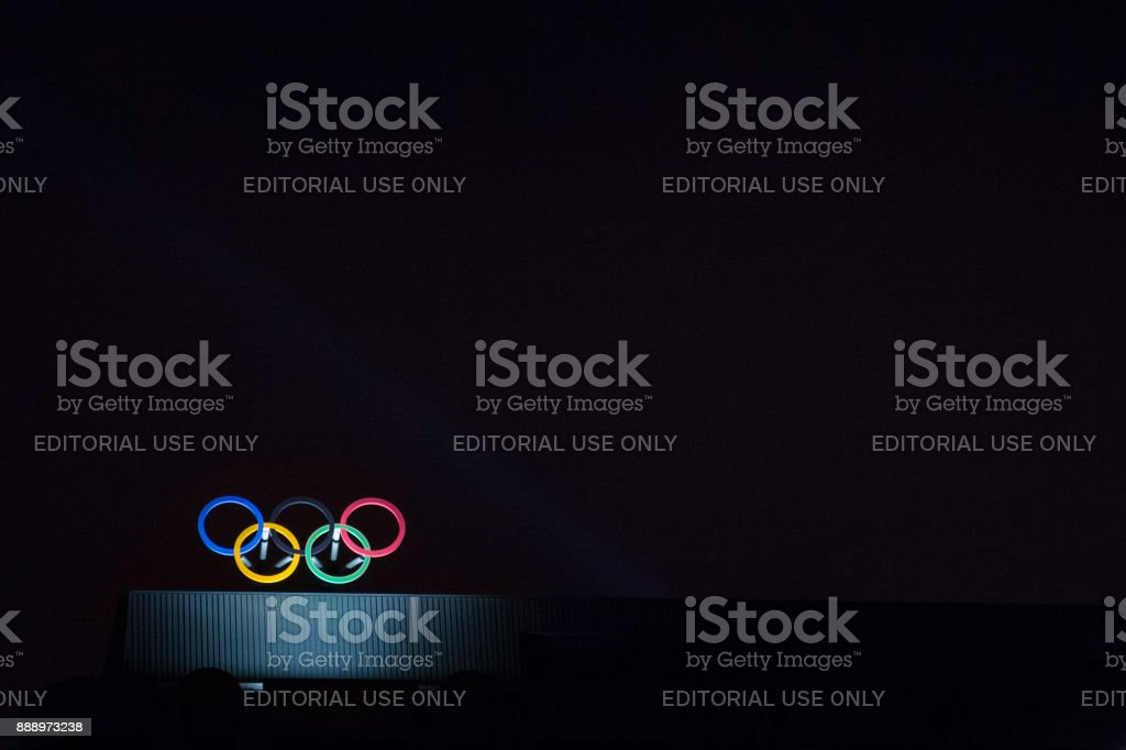 Olympic symbol (also known as Olympic Rings) seen on the Montreal olympic Committee building lit during a dark night. Montreal became an olympic city with the 1976 Summer Olympic Games stock photo