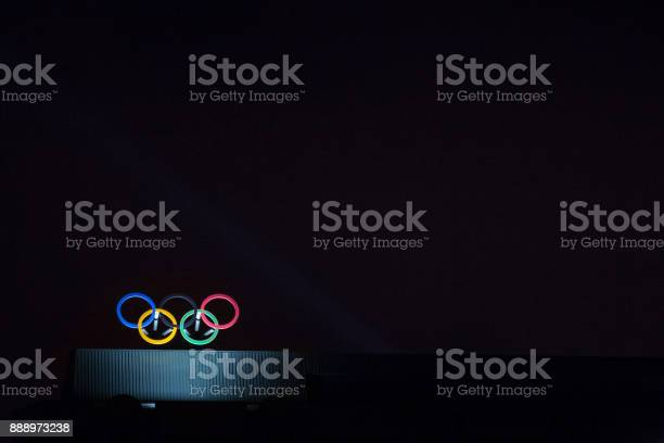 Olympic symbol (also known as Olympic Rings) seen on the Montreal olympic Committee building lit during a dark night. Montreal became an olympic city with the 1976 Summer Olympic Games