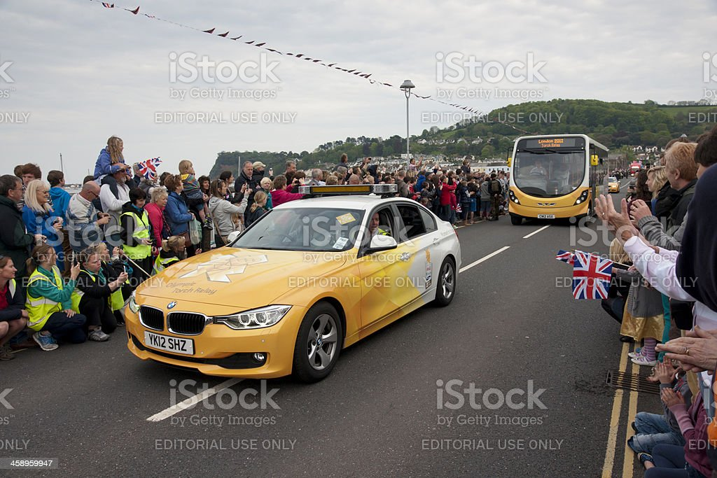 Olympic torch relay vehicles crossing Shaldon bridge royalty-free stock photo