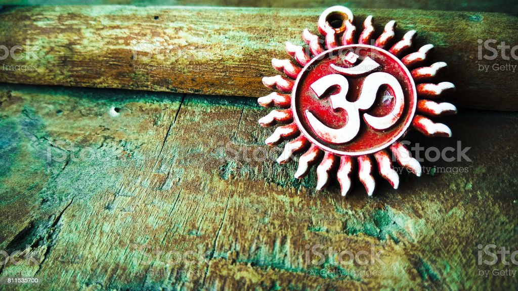 om pendent on wood texture background and greeting stock photo