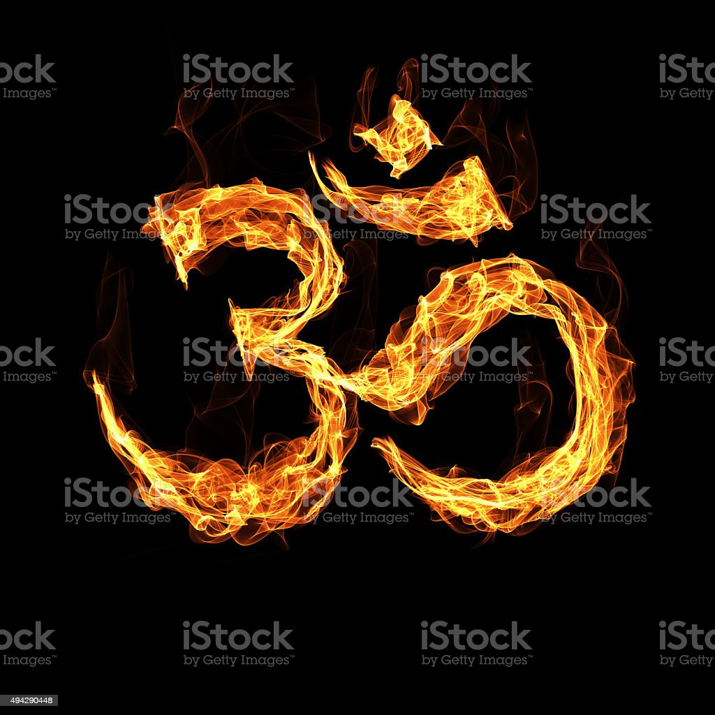 Om sign by fire stock photo