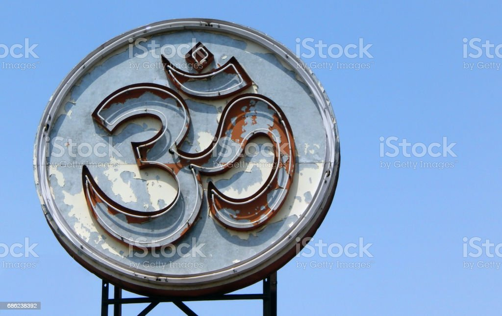 Om sign or religious symbol sanskrit language letter of Hinduism electric installation in a Hindu Temple stock photo