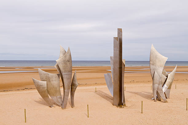 Omaha Beach D-Day Memorial Memorial on Omaha Beach in Normandy, France commemorating the D-Day battle in World War II normandy stock pictures, royalty-free photos & images