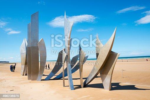 Laurent-sur-Mer, Normandy, France - May 13, 2014: Visitors to Omaha Beach walk around the sculpture entitled