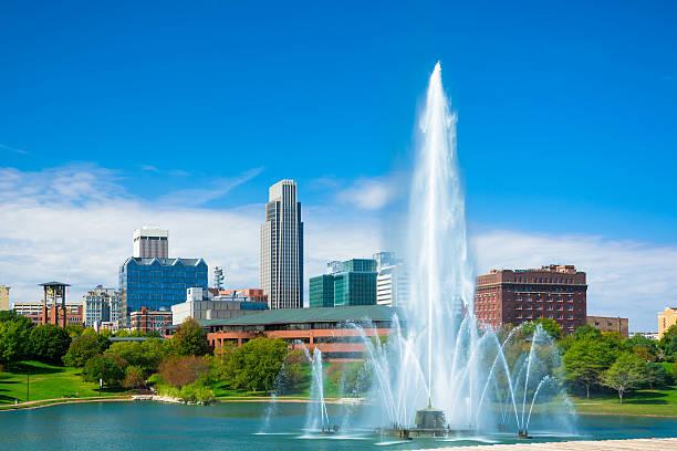 Omaha skyline with fountain and lake stock photo