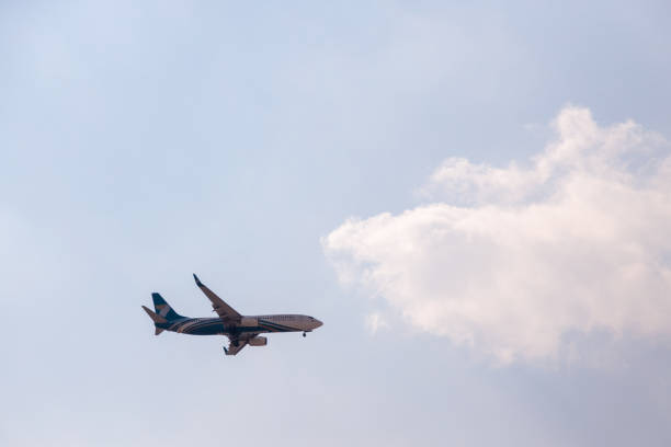 Oman Air Airline Boeing 737 approaching Dubai International Airport for landing stock photo