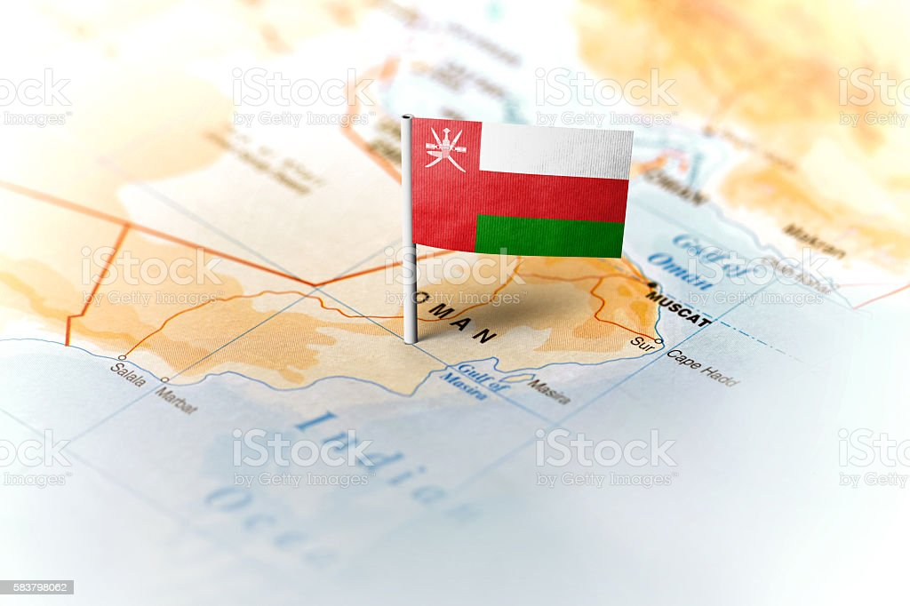 Oman pinned on the map with flag stock photo