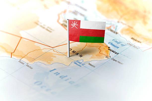 oman pinned on the map with flag - oman стоковые фото и изображения
