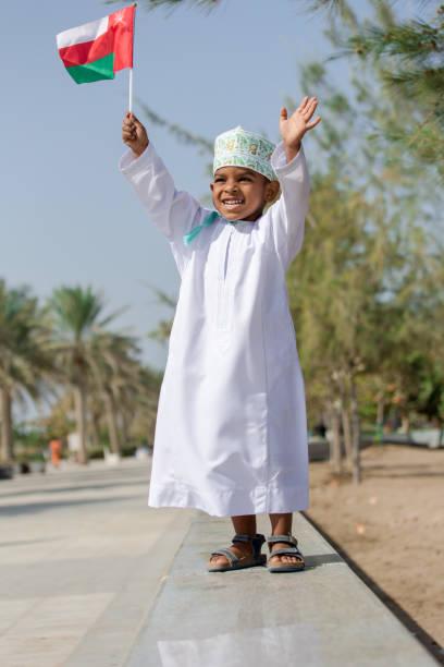 omani boy fun by the beach - oman стоковые фото и изображения