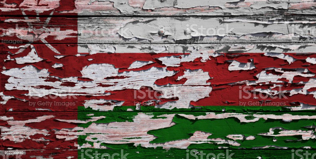 Omani flag painted on a grunge plank stock photo