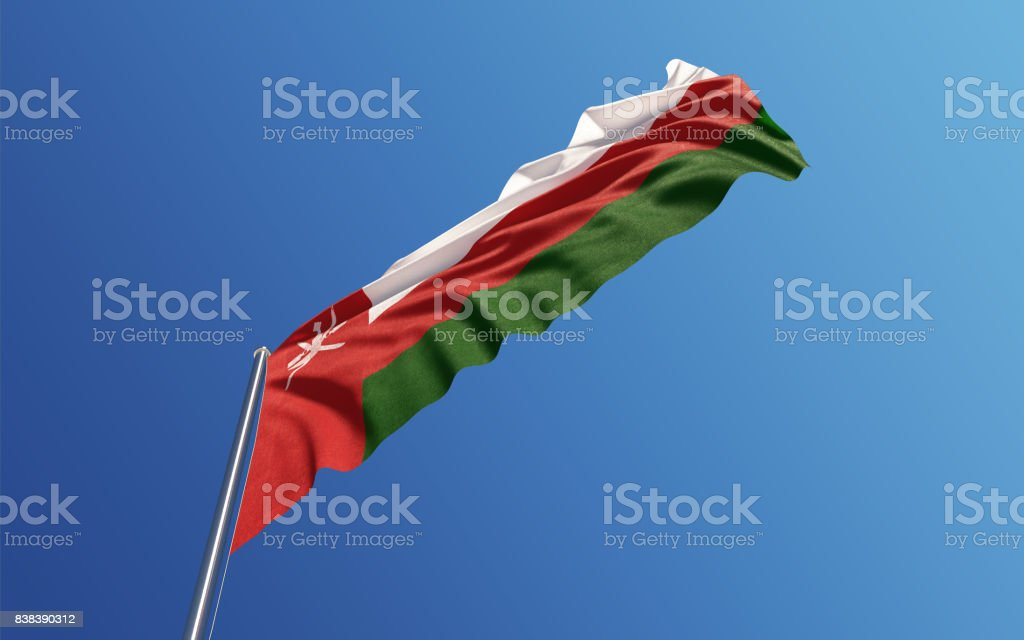 Omani Flag Waving With Wind On Blue Sky stock photo