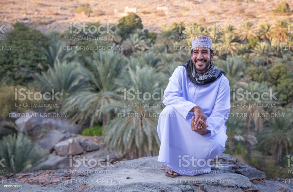Omani man in traditional clothing stock photo