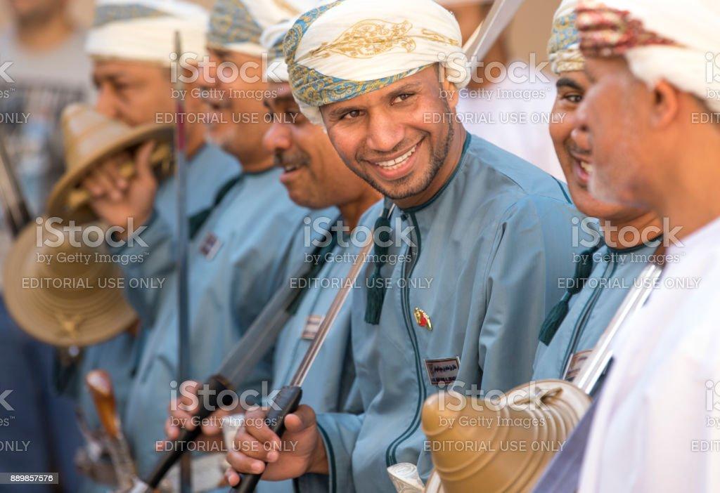 Omani men celebration by dancing stock photo