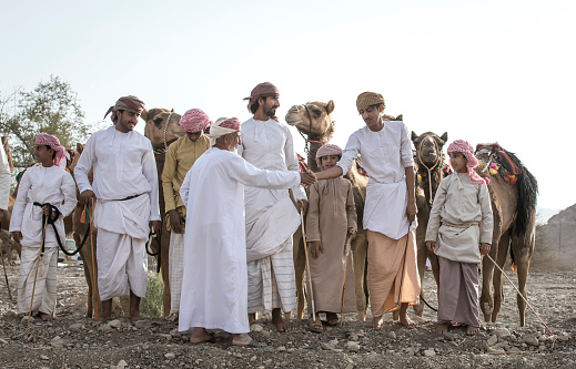 khadal, Oman, 7th April 2018: omani men in traditional clothing, greeting their elders during Eid Al Fitr, holiday celebrating the completion of Holy Month of Ramadan