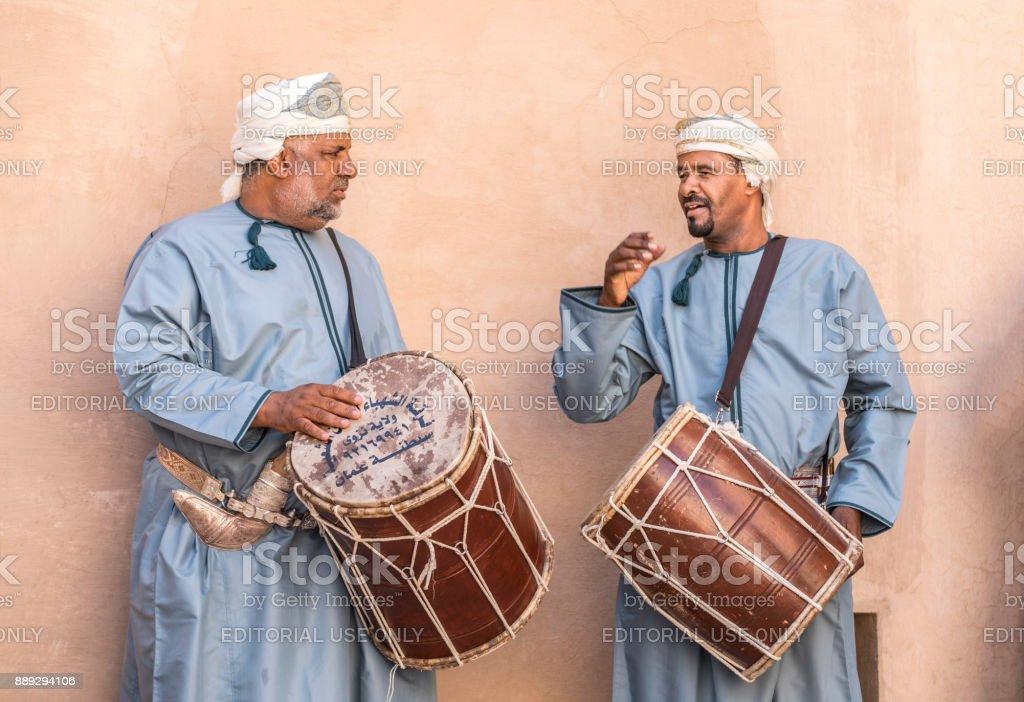 Omani men playing drums stock photo