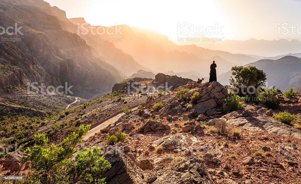 Omani woman in the mountains stock photo