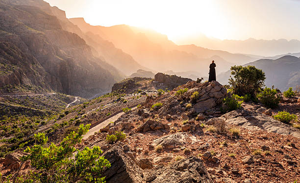 omani woman in the mountains - oman travel stock-fotos und bilder