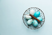 Ombre Easter eggs in a wire basket
