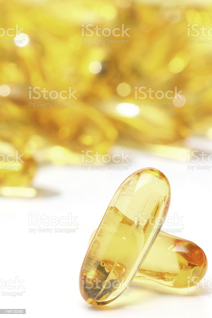 Omega 3, gold pills isolated royalty-free stock photo