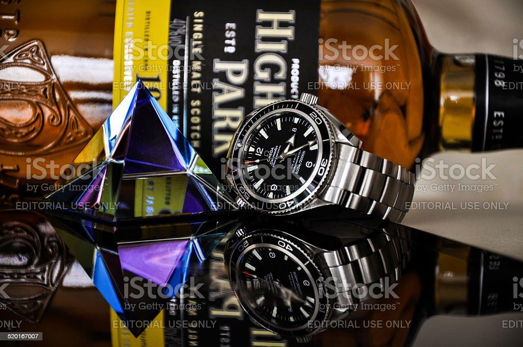 Omega watch with Highland Park Scotch Whisky stock photo